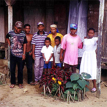 Elizé and his family with Jean Christian